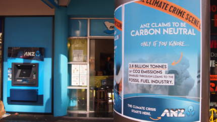 "Poster reads ""ANZ claims to be carbon only if you ignore the 2.8 billion tonnes of carbon enabled through loans to the fossil fuel industry. The climate crisis starts here -ANZ"" ANZ atm in background"
